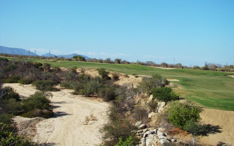 The three shot ninth sweeps left around this sixty foot deep arroyo.