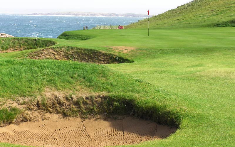 ... fifth greens hugging the coast at the nine hole Cruit Island, don't miss playing here!