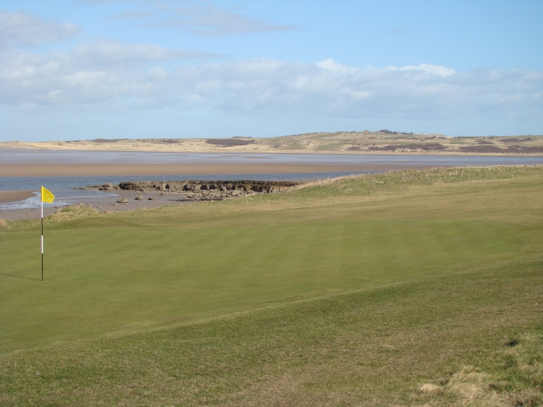 One gains a sense of the long rectangular nature of the third green in this side view.