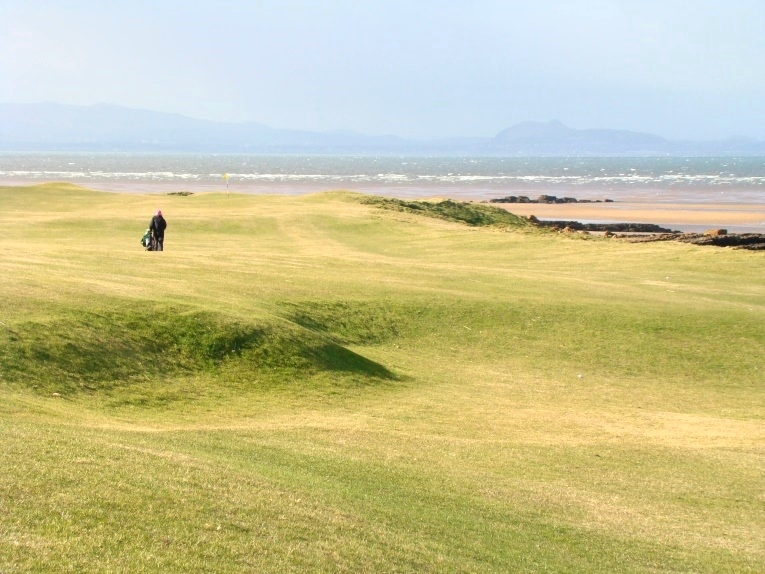 This depression apparently was once a bunker, pinching the fairway down to just fifteen paces from the shoreline.