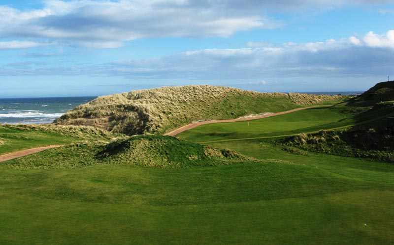 The view of the fifteenth green from the from the eighth hole shows the combination of wonderful land and natural setting that make Cruden Bay so special.