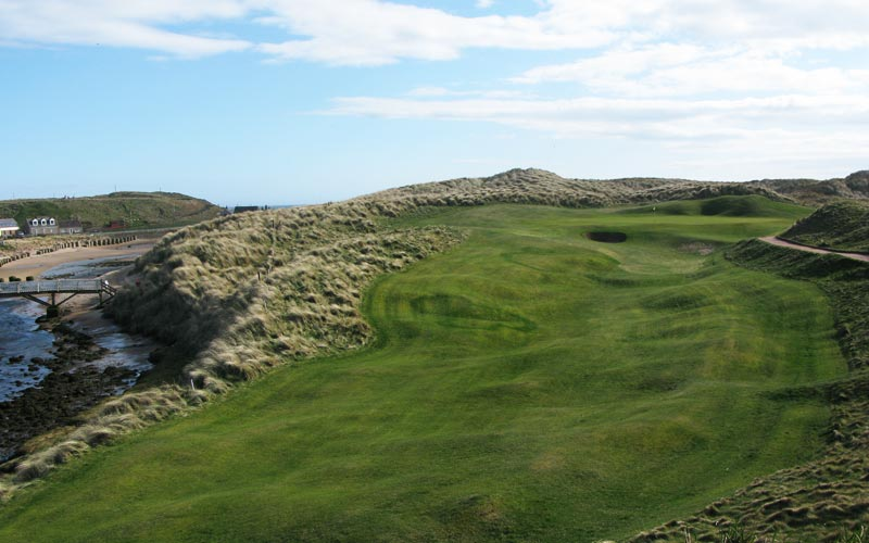 The brutish fourth at Cruden Bay, with the river left and the dunes right, only a well-struck shot is rewarded.