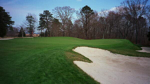 The left side of the 11th green is three feet higher than the right side and working a ball on to the lower