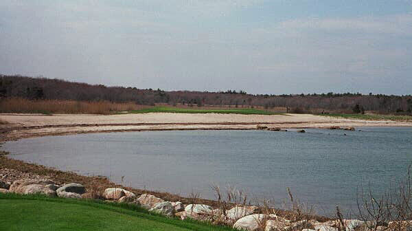 Looking from the tee across the Bay to the green surrounded by beach, the picture doesn't capture