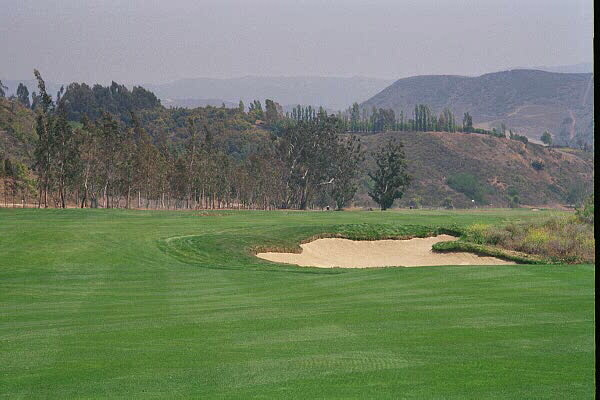 A seventy yard wide fairway greets the golfer off the 1st tee once he carries this short bunker.