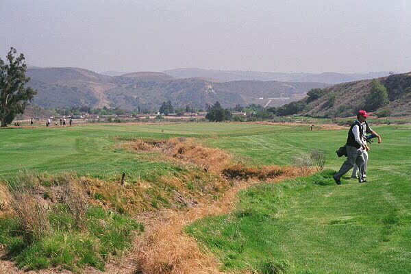 This fault line starts in the left side of the fairway 140 yards from the green before...