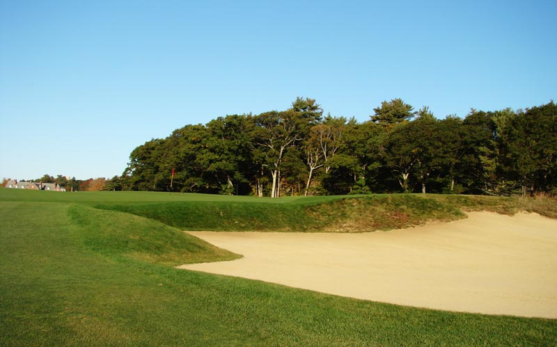 Bruce Hepner helped the Club expand the right greenside bunker another fifteen yards to the right.