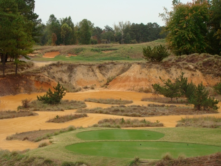 The formidable 18th tee shot requires a 200 yard carry from the back markers to clear the quarry.