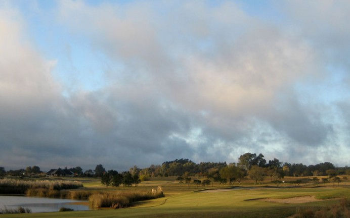 Even if the golfer reaches here at the top of the lake in two, he still faces a challenging approach shot of 130 yards.