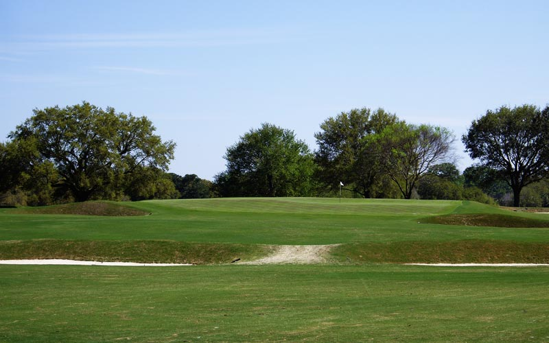 The approach to the built-up fourteenth requires absolute precision. Long is death while anything that lands on the green's front quarter is likely to roll back and off.