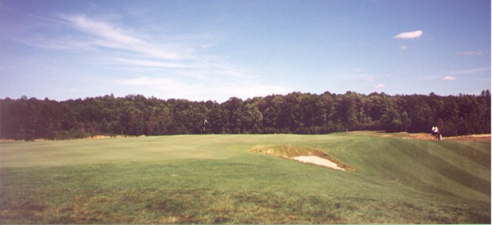 This view from the back-left of the 13th green shows the 'safe' play to the left off the tee leaves no bargain of a chip shot.  The bunker in the foreground dominates play when the hole is in the narrow rear neck of the green.