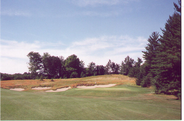 The difficult approach to the small, raised 15th green.