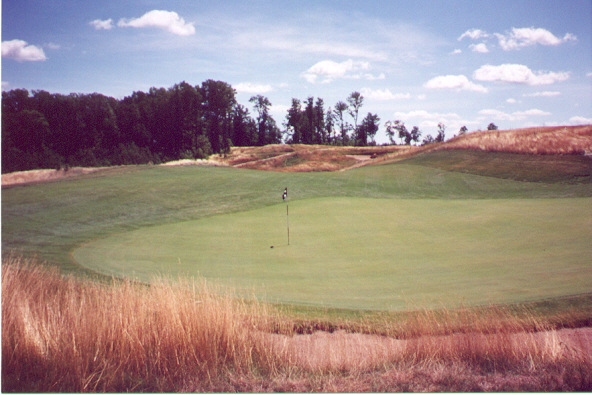 as this view from behind the hole shows, the punchbowl green is receptive, appropriate for a