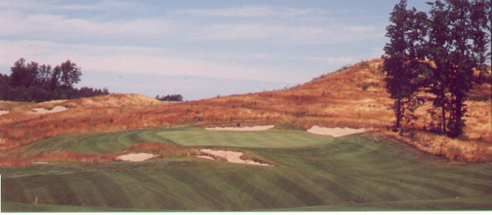 The 7th green set into the hillside.