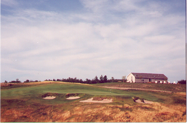 The 9th from the south tee, with the temporary clubhouse beyond the green.