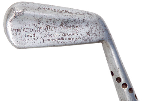 This Redan Iron is equal to a modern 3-4 Iron, just about perfect for the Redan. According to  Livingston, the interesting things about this one  are the bar running across the lower back for weighting and the Maxwell Hosel, with the weight drilled out of the Hosel.
