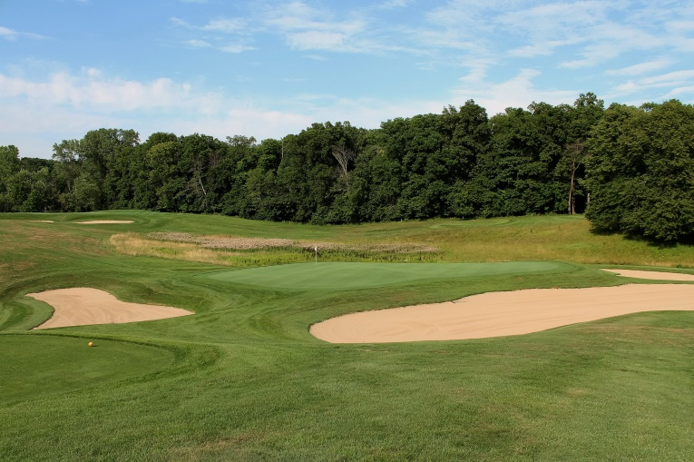 Langford & Moreau spread 36 bunkers across the original nine holes and Bobby Weed gave the school wise counsel when he insisted that each one be restored. This view is across the 3rd green with the 2nd green in the distance - the two par 3s combine for 11 of the bunkers!