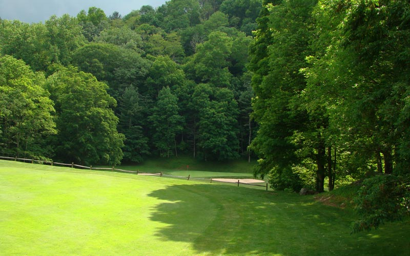 ... drop-offs that take the golfer down sixty feet to a green in a river bed.