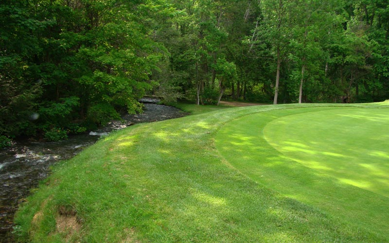 Front left hole locations are particularly cruel as the stream hugs the left side of the green.