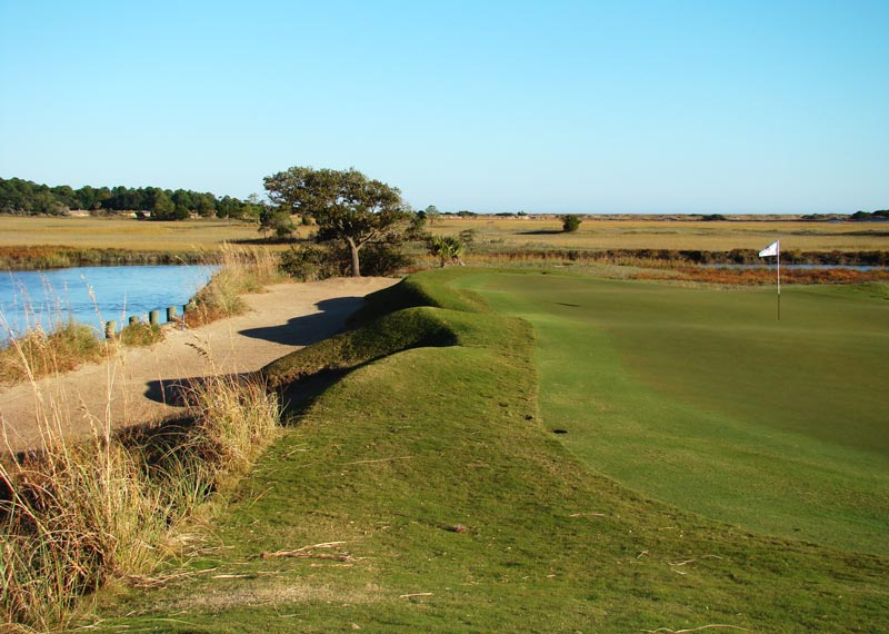 The fifteenth green at Cassique juts into the marsh at the end of a reachable par five.