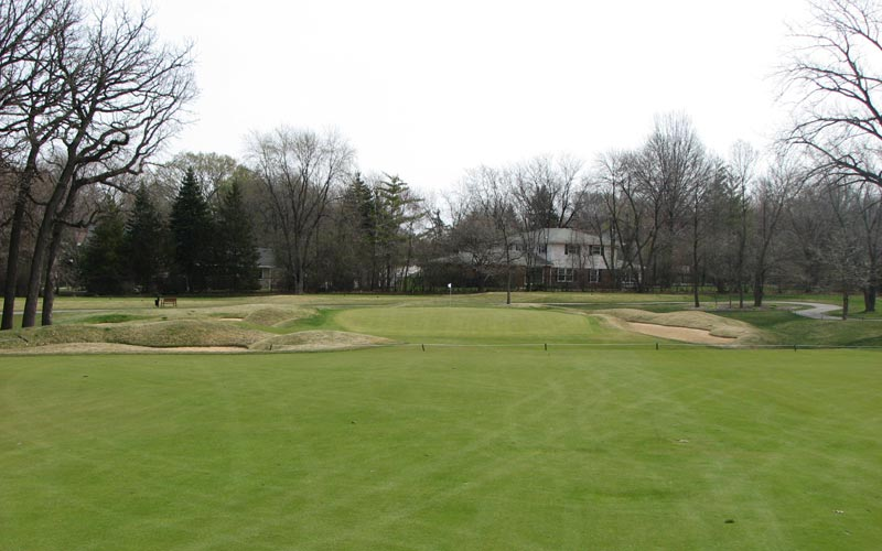 The approach to sixteen, showing the bunker threatening players attempting to drive the green.