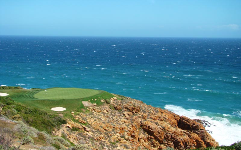 The downhill par three seventh is but one of the spectacular cliffline holes at Pinnacle Point.