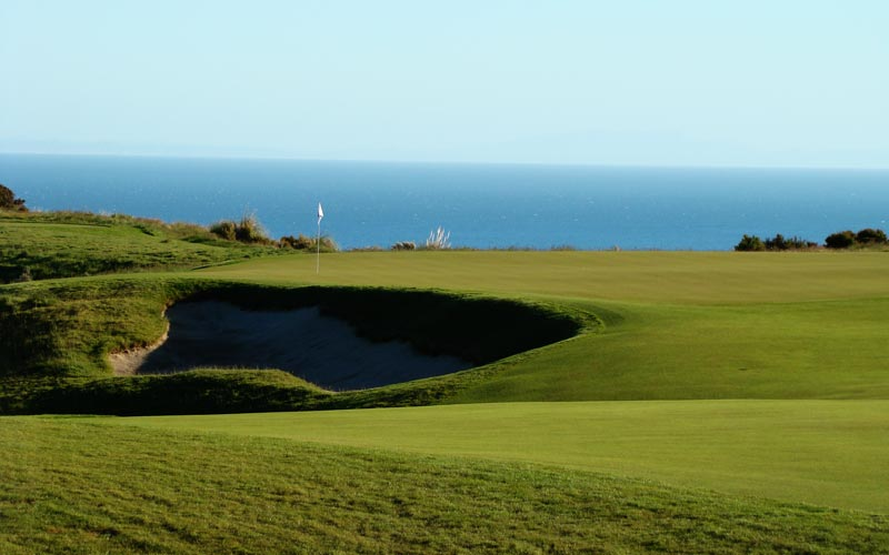 Note how the bunker was cut into the landform and is below the surface of the tenth green. According to Hepner, ' The bunkers were kept deep but quiet in nature to take advantage of the dark shadows cast at any time of the day.  The sand lines were also kept in a low profile due to the occasional high wind days.' In addition, another virtue of the bunker construction as presented here is that the golfer enjoys the pleasure of watching his ball slowly roll across the green.
