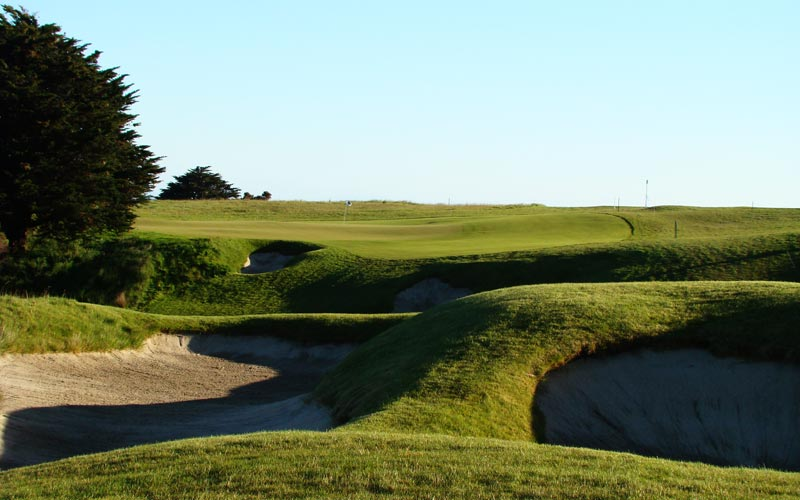 The ninth fairway tumbles downhill just past these two left side fairway bunkers. A tee ball near these bunkers leaves the golfer with an excellent view of the green and an approach shot of approximately 140 yards.