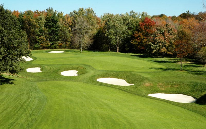 Though the cross hazards obscure a view of the putting surface from the fairway's lower level, this aerial view shows that the green is open in front and approach shots can be bounced in.