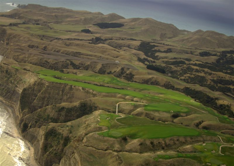 As seen in the bottom middle of Joann Dost's aerial photograph, the long bunkerless twelfth takes the golfer back to the cliffs. With its tee behind the twelfth green, the thirteenth is the only hole on the course that plays in a southerly direction.