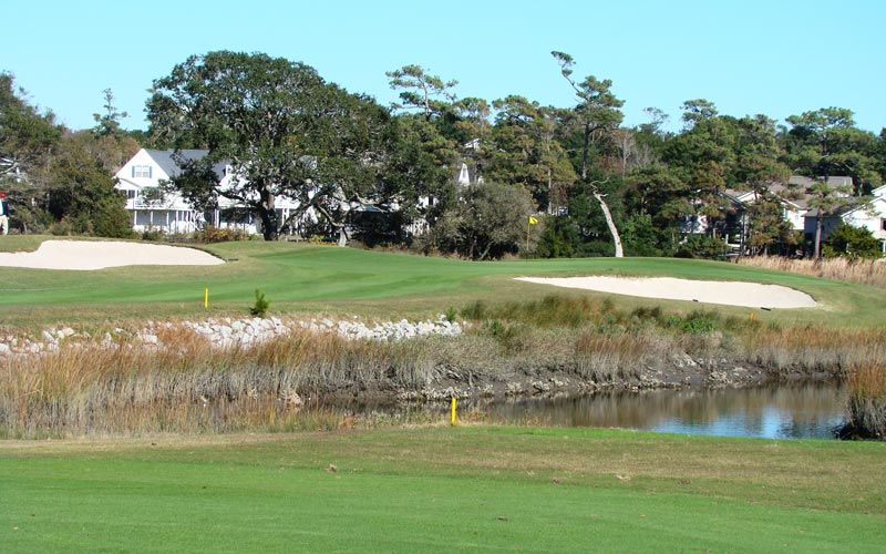 Protruding into the marsh, the eleventh green complex presents one of the most demanding targets on the course as its soft shoulders right and behind do nothing but help feed balls into the marsh.