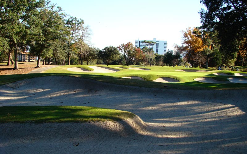The sixteenth is a placement hole and this fairway bunker with its island needs to be avoided off the tee.