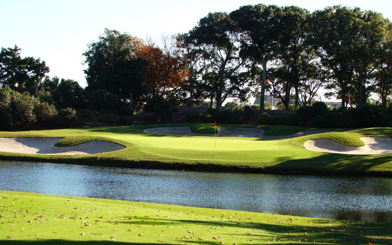 One's score is not safe until after negotiating the pond in front of the eighteenth green.