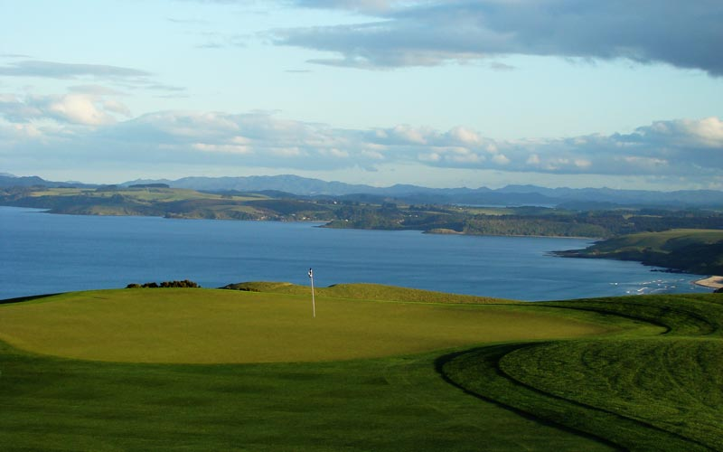 ... with the rolling countryside and Matauri Bay providing a remarkable backdrop to the first green.