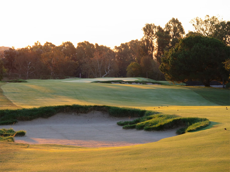 Played high along an ever narrowing finger of land, the sixteenth asks the golfer to squeeze his tee ball past the left bunker and then avoid the right bunker eight yards shy of the putting surface.