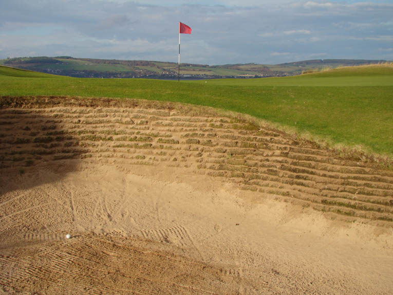 One type of recovery shot is demanded from the front left revetted bunker.
