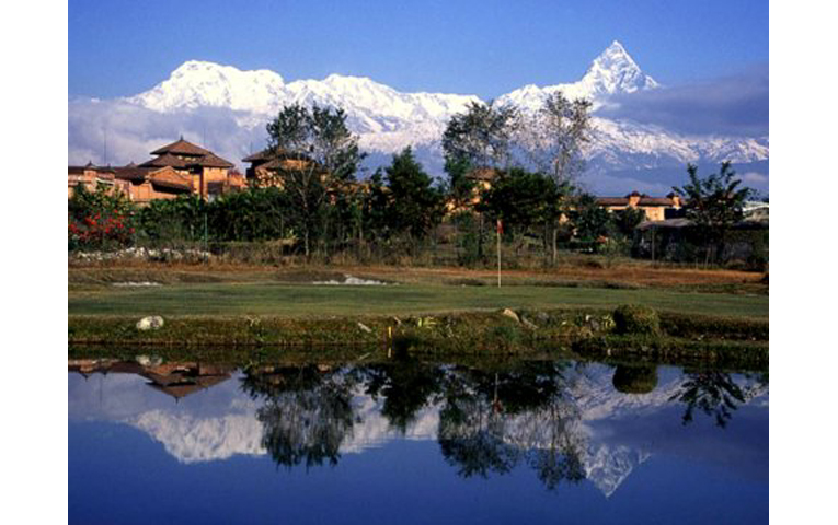 The 9th/18th green at the Yeti's Golf Course at Fulbari Resort, with Annapurna south, Annapurna 1 and Fishtail beyond. (Photo from Ron Fream).