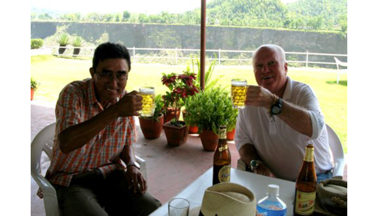 The Major and Ron Fream enjoy one of Nepal's finest cleansing refreshments.