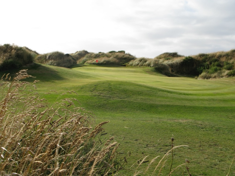 The fourth green at Oreti Sands nestles low in the dunes.