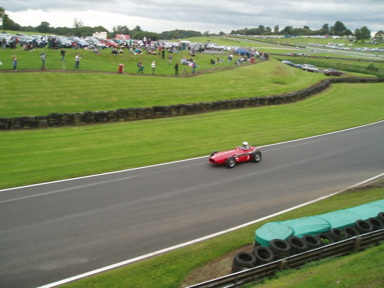 A Maserati 250F taking part in historic motor racing at Oulton Park, Cheshire.