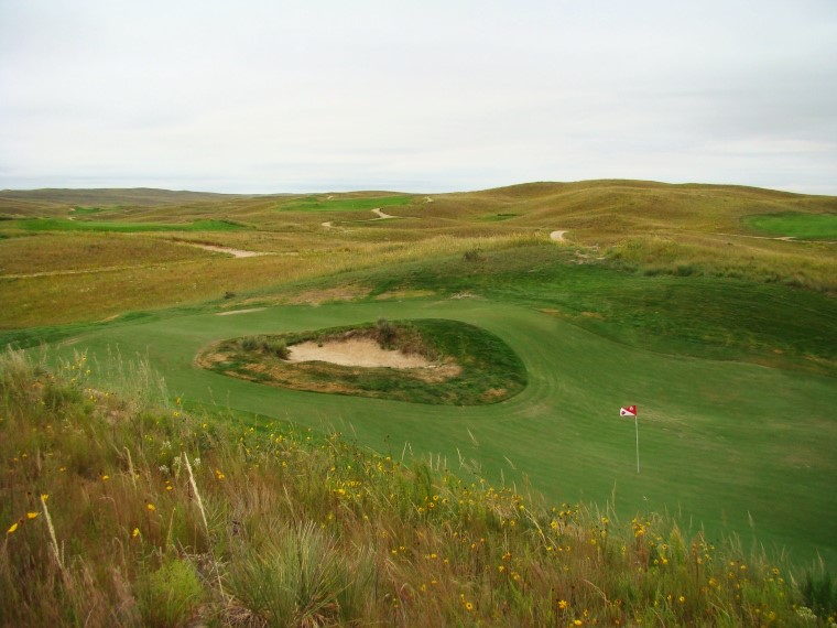 As seen from high right behind the green, the 57 yard deep green at the tenth affords all sorts of hole locations.