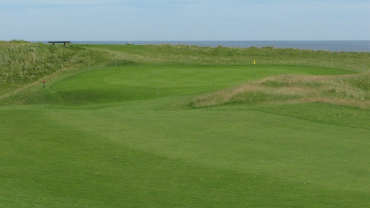 The attractive pitch to the sloping first green.