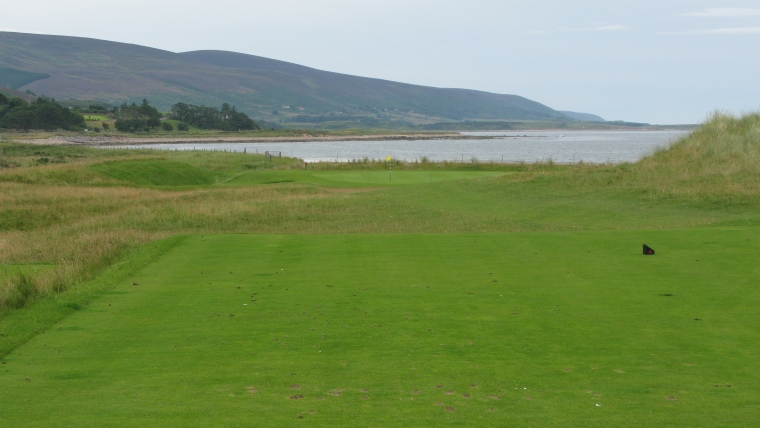 The ninth green, complete with sheep fence, hard by the shore.