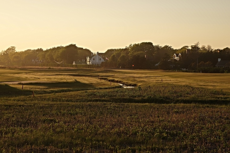 "A view out over the aptly named ""Marshes"" hole at Quogue Field Club, with a distinctive orange flag punctuating the horizon."