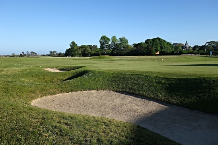 The bunkering at Quogue, here guarding the right side of the home green, calls to mind other classic early American golf courses, such as Garden City. Note the bike rack, immediately inside the club's entrance, next to the first tee off on the right—a clear reminder that QFC is a neighborhood club.