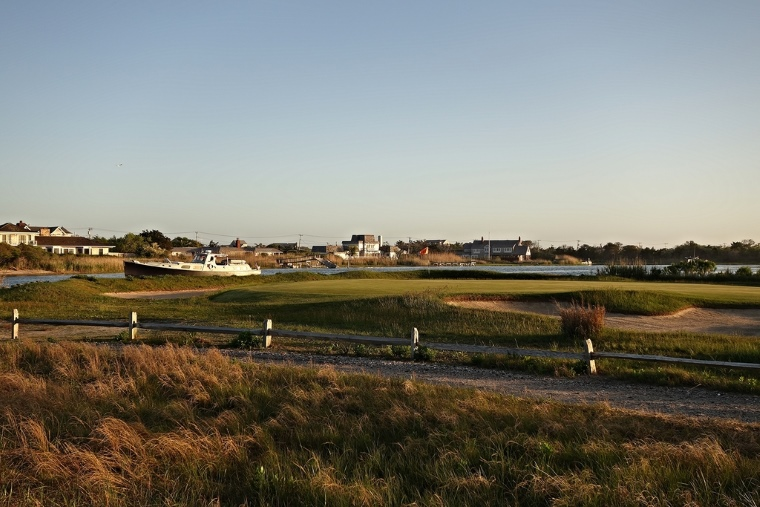 From bikes, to cars, to boats (here, along Quogue Canal behind the 5th green), golf at QFC is an immersive, interactive experience with the village and its inhabitants.