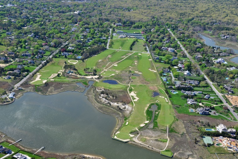 A close-up May 2015 aerial of QFC (Credit: Vincent T. Vuoto/BestAerialPhotos). Note the Church Pews along the left of the 3rd fairway and the extended scar bunker intruding into the fairway from the right. According to Google Earth, the Church Pews were added in the 2007-2008 timeframe. Note also the renewed absence of interior trees, especially between the 1st and 9th holes (top center) and 7th and 8th holes (middle right)—a credit to the recent Ian Andrew-led restoration. In the foreground are the 5th green and 6th tee, the closest the golfer gets to the bay and ocean at QFC.