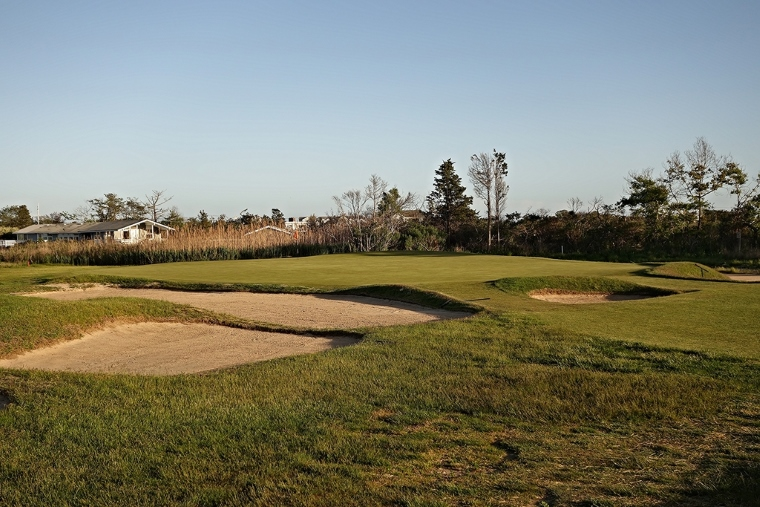 The green, surrounded by bunkers on all sides and nestled into the reeds at the edge of Shinnecock Bay, is one of the flattest and largest on the course. Note the rare fronting bunker at the green's entrance—an anomaly at QFC, but warranted at the 3rd given the shortness of the approach shot and the size of the green.