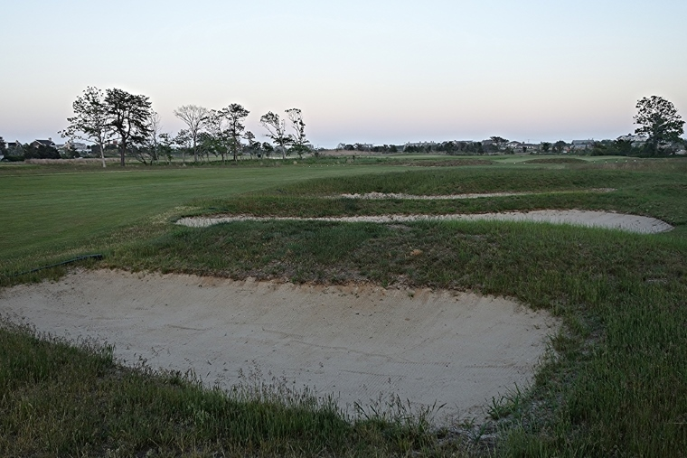A series of three strip bunkers guards the right side of this wide fairway. Some have noted the resemblance to those at Pine Valley's 2nd hole. According to historical aerials, these bunkers appear to have been added for the first time in the 1970s (and, then, only as two before eventually becoming three).