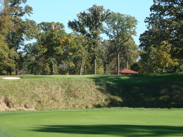 The green is ninety yards back from the steep river valley wall. A modern architect might have stuck it dead on top for drama. Such a do-or-die approach would overwhelm the average player. As Park has it, the hole is much longer, and indeed grander. Recovery shots around his green complex are some of the most ticklish on the course. In autumn the hole can't be placed in the middle of the green, so pronounced is its back to front slope.